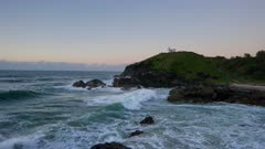 wide shot at dawn of tacking point lighthouse at port macquarie in nsw, australia