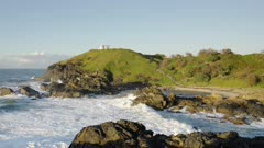 sunrise view of the tacking point lighthouse headland and beach at port macquarie in nsw, australia