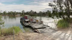 a close shot of the cable ferry at swan reach on the murray river departing