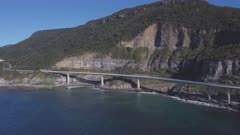 an aerial panning shot of sea cliff bridge at stanwell park on the nsw south coast of australia