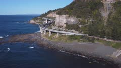 an aerial view to the south of sea cliff bridge while flying sideways at stanwell park on the nsw south coast of australia