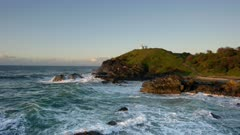 a wide angle view of tacking point lighthouse at sunrise in port macquarie of nsw, australia