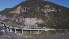 aerial shot flying sideways of sea cliff bridge at stanwell park on the nsw south coast of australia