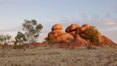 zoom in sunset shot of the devil's marbles in the northern territory