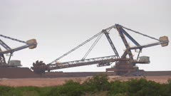 an iron ore stacker loader in operation at port hedland in western australia