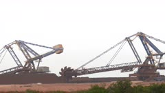 zoom in on an iron ore loader in operation at port hedland in western australia