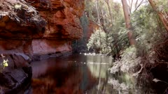 the sun shining on a pool of water at the garden eden in kings canyon in watarrka national park of the northern territory, australia