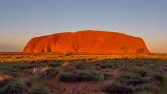 a close sunset timelapse of uluru in uluru-kata tjuta national park of the northern territory, australia