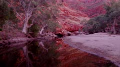 a sunrise zoom in shot of in ormiston gorge in tjoritja / west macdonnell national park of the northern territory, australia