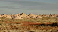 a pan of mullock heaps from opal mines at coober pedy in outback south australia
