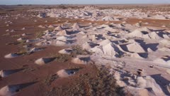 an ascending aerial shot of opal mine mullock heaps at coober pedyy in outback south australia