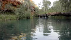 a wide view of the waterfall at the fern pool at dales gorge in karijini national park of western australia