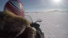 Traveling on a snowmobile in the Arctic