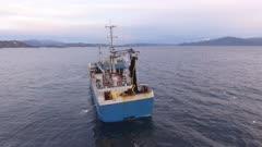 Fishing trawler in North atlantic, Norway, 4K aerial