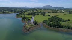 Ireland, aerial view of Doe castle at the shore of a lake, backwards move