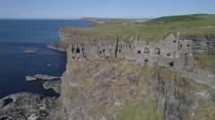 Ireland, aerial view of Dunluce castle with Antrim coastline, backwards move
