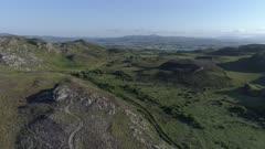 Ireland, aerial flight over Fanad peninsula with green hills, forward move