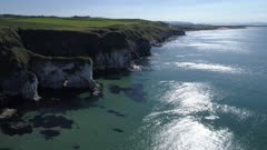 Aerial view of white cliffs coastline, Antrim Ireland, forward move