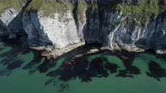 Aerial view of white cliffs coastline, Antrim Ireland, sidewards move