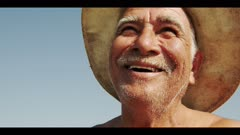 Old Fisherman Seen Smiling. Close Portrait On His Face. Shot In Mexico.