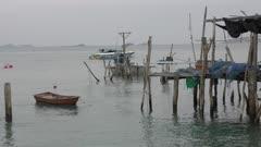4k - 20min island boats resting near old pier, kayaker