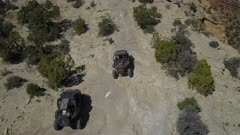 Aerial recreation off road 4x4 San Rafael Utah desert follow. San Rafael Reef geologic landscape central Utah. Eroded into tall fins, domes, cliffs, and deep canyons.  Hikers, backpackers, horseback riders, off road and 4x4 all terrain vehicle ( ATV, UTV and SxS ) enthusiasts enjoy extreme recreation. Dangerous wilderness desert environment. Wilderness area. 4K HD video footage. Despain Rekindle Photo. 198
