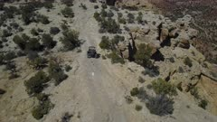 Aerial recreation off road 4x4 San Rafael Utah desert follow part 2. San Rafael Reef geologic landscape central Utah. Eroded into tall fins, domes, cliffs, and deep canyons.  Hikers, backpackers, horseback riders, off road and 4x4 all terrain vehicle ( ATV, UTV and SxS ) enthusiasts enjoy extreme recreation. Dangerous wilderness desert environment. Wilderness area. 4K HD video footage. Despain Rekindle Photo. 198