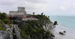 Tulum Mexico Mayan ruins temple ocean cliff. Pre Columbian Mayan ancient walled city along coast. Built on cliff over looking beach and Caribbean Ocean east shore of Yucatan Peninsula. Today a popular site for tourists. El Castillo, the Temple of the Frescoes, and the Temple of the Descending God are the three most famous buildings. DCI 4K HD video footage. Despain Rekindle Photo. 112