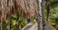 Tropical resort Mexico thatched grass huts on beach. Luxury resort on Mexican Mayan Riviera near Cancun. Swimming pools, beach, tropical jungle and warm recreation activities. Caribbean ocean destination for vacation and business. Tourist and tourism refreshing blue water. Family, honeymoon and couple travel trip. DCI 4K HD video footage. Despain Rekindle Photo. 859