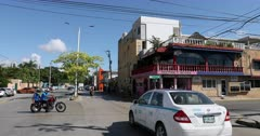 Mexico Playa del Carmen transportation fast motion. Tourist destination for Luxury resorts along Mexican Mayan Riviera near Cancun. Local business and residents along road intersection. Busy street, Mexican culture and lifestyle. Urban city center. Caribbean ocean vacation. Family, honeymoon and couple travel trip. Driving car, trucks, bus and motorcycle. DCI 4K HD video footage. Despain Rekindle Photo. Time lapse. 538