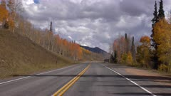 Beautiful autumn drive mountain road time lapse POV. Beautiful season Autumn fall colors in Aspen Pine forest. Skyline Drive Manti La Sal Forest central Utah. Golden yellow, red and orange  leaves. Exploring natural scenic landscape before winter. High mountain peaks and plateau. Nature and creations of Earth. 4K UHD HD video footage. Despain Rekindle Photo. 004