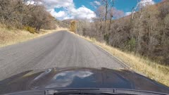 POV front of car hood mountain canyon fast motion. Beauty of seasonal Autumn colors exploring high mountain roads and trails. Point of view, POV high mountain and valley. Fall colors, beautiful nature before winter sets in. Outdoors and landscape. Mount Nebo Scenic Byway. Forest Aspen and pine trees. Exploring. Popular travel drive in central Utah. HD footage video. Despain Rekindle Photo. 962