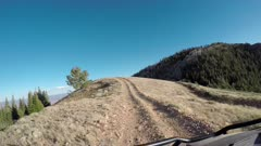 Trail ride 4x4 off road mountain top recreation POV. Enjoy beauty of seasonal Autumn colors early winter, exploring high mountain roads and trails. Riding sports utility vehicle UTV side by side 4x4 4 wheel drive ATV high mountain and valley. Fall colors, beautiful nature before winter sets in. Great outdoors and landscape. Forest Aspen and pine trees. Exploring. Popular travel and sport drive in central Utah. 4K HD footage video. Despain Rekindle Photo. 941