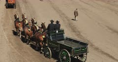 Beautiful Draft horses and wagons enter judge. Gentle Giant draft horse pull heavy antique wagons. Highly trained and decorated to demonstrate traditional farm and industrial use. Heavy, tall and strong. Working farm animal used to pulling heavy loads. Competition, show, demonstration trials. Can weigh up to 3,000 pounds. DCI 4K video footage. Despain Rekindle Photo. 594