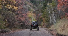 Mountain road Autumn colors recreation vehicle away fast. Enjoy beauty of seasonal Autumn colors early winter, exploring high mountain roads and trails. Riding sports utility vehicle UTV side by side 4x4 4 wheel drive ATV high mountain and valley. Fall colors, beautiful nature before winter sets in. Great outdoors and landscape. Forest Aspen and pine trees. Exploring. Popular travel and sport drive in central Utah. 4K HD footage video. Despain Rekindle Photo. 469