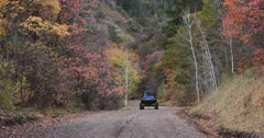 Mountain road Autumn colors recreation vehicle towards. Enjoy beauty of seasonal Autumn colors early winter snow, exploring high mountain roads and trails. Riding sports utility vehicle UTV side by side 4x4 4 wheel drive ATV high mountain and valley. Fall colors, beautiful nature before winter sets in. Great outdoors and landscape. Forest Aspen and pine trees. Exploring. Popular travel and sport drive in central Utah. 4K HD footage video. Despain Rekindle Photo. 469