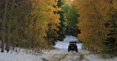 Mountain road snow autumn forest recreation off road. Enjoy beauty of seasonal Autumn colors early winter snow, exploring high mountain roads and trails. Riding sports utility vehicle UTV side by side 4x4 4 wheel drive ATV high mountain and valley. Fall colors, beautiful nature before winter sets in. Great outdoors and landscape. Forest Aspen and pine trees. Exploring. Popular travel and sport drive in central Utah. 4K HD footage video. Despain Rekindle Photo. 490