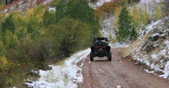 Recreation off road vehicle mountain road autumn fall colors. Enjoy beauty of seasonal Autumn colors, exploring high mountain roads and trails. Riding sports utility vehicle or UTV side-by-side 4x4 4 wheel drive ATV through the high mountain and valley during autumn. Fall colors, beautiful nature before winter sets in. Great outdoors and landscape. Forest Aspen and pine trees. Exploring. Popular travel and sport drive in central Utah. 4K HD footage video. Don Despain of Rekindle Photo. 485