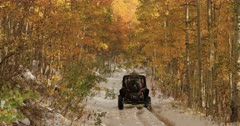 Sport recreation off road winter snow autumn leaves fast. Enjoy beauty of seasonal Autumn colors early winter snow, exploring high mountain roads and trails. Riding sports utility vehicle UTV side by side 4x4 4 wheel drive ATV high mountain and valley. Fall colors, beautiful nature before winter sets in. Great outdoors and landscape. Forest Aspen and pine trees. Exploring. Popular travel and sport drive in central Utah. 4K HD footage video. Despain Rekindle Photo. 520