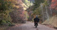 Mountain forest road motorcycle Autumn tree colors. Enjoy beauty of seasonal Autumn colors early winter snow, exploring high mountain roads and trails. Riding cycle, sports utility vehicle UTV side by side 4x4 4 wheel drive ATV high mountain and valley. Fall colors, beautiful nature before winter sets in. Great outdoors and landscape. Forest Aspen and pine trees. Exploring. Popular travel and sport drive in central Utah. 4K HD footage video. Despain Rekindle Photo.