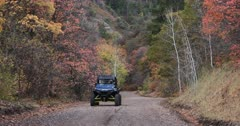 Mountain road Autumn colors recreation vehicle towards fast. Enjoy beauty of seasonal Autumn colors early winter snow, exploring high mountain roads and trails. Riding sports utility vehicle UTV side by side 4x4 4 wheel drive ATV high mountain and valley. Fall colors, beautiful nature before winter sets in. Great outdoors and landscape. Forest Aspen and pine trees. Exploring. Popular travel and sport drive in central Utah. 4K HD footage video. Despain Rekindle Photo. 469