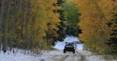 Mountain road snow autumn forest off road vehicle. Enjoy beauty of seasonal Autumn colors early winter snow, exploring high mountain roads and trails. Riding sports utility vehicle UTV side by side 4x4 4 wheel drive ATV high mountain and valley. Fall colors, beautiful nature before winter sets in. Great outdoors and landscape. Forest Aspen and pine trees. Exploring. Popular travel and sport drive in central Utah. 4K HD footage video. Despain Rekindle Photo. 491