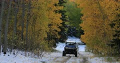 Mountain road snow autumn forest off road vehicle fast. Enjoy beauty of seasonal Autumn colors early winter snow, exploring high mountain roads and trails. Riding sports utility vehicle UTV side by side 4x4 4 wheel drive ATV high mountain and valley. Fall colors, beautiful nature before winter sets in. Great outdoors and landscape. Forest Aspen and pine trees. Exploring. Popular travel and sport drive in central Utah. 4K HD footage video. Despain Rekindle Photo. 491