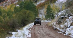 Recreation off road vehicle mountain road autumn colors snow. Enjoy beauty of seasonal Autumn colors, exploring high mountain roads and trails. Riding sports utility vehicle or UTV side-by-side 4x4 4 wheel drive ATV through the high mountain and valley during autumn. Fall colors, beautiful nature before winter sets in. Great outdoors and landscape. Forest Aspen and pine trees. Exploring. Popular travel and sport drive in central Utah. 4K HD footage video. Don Despain of Rekindle Photo. 486