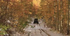 Sport recreation off road winter snow autumn leaves forward. Enjoy beauty of seasonal Autumn colors early winter snow, exploring high mountain roads and trails. Riding sports utility vehicle UTV side by side 4x4 4 wheel drive ATV high mountain and valley. Fall colors, beautiful nature before winter sets in. Great outdoors and landscape. Forest Aspen and pine trees. Exploring. Popular travel and sport drive in central Utah. 4K HD footage video. Despain Rekindle Photo. 520