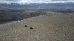 Aerial friends recreation vehicles mountain top landscape. Top of mountain central Utah. Off road 4x4 recreation ATV vehicles. Peak formed by volcanic ash and eruption debris. Rugged landscape and scenic remote wilderness area. Recreation destination for hiking, exploring and riding off road recreation 4x4 vehicles.