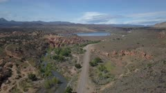 Aerial Gunlock Lake desert river valley Utah. In southwest Utah near Nevada border. Rural farming area. Desert area, mountain valley, volcanic lava flows, river valley and Gunlock Reservoir built to control flooding and supply irrigation. On the old historic Spanish Trail to California. State Park offers boating, fishing, hiking and off road exploring. 4K HD video footage. Despain Rekindle Photo. 105