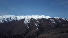 Aerial Mount Nebo WIlderness area Spring snow slide. Winter snow on landscape of central Utah. Cold season weather. Nature and environment. Beautiful natural environment. Drone flight above ground. 4K HD video footage. Despain Rekindle Photo. 938