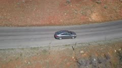 Aerial mountain road curve following car by drone. Follow tracking car while exploring wilderness scenic mountain road environment. Landscape central Utah. Early spring with new growth in forest. Nature and environment. Beautiful natural view. Drone flight above vehicle. 4K HD video footage. Despain Rekindle Photo. 944