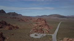 Aerial Nevada Desert Lake Mead Recreation Area red rock. Near Valley of Fire State Park is a public recreation and nature preservation area Nevada. Scenic desert landscape mountains. By shore of Lake Mead recreation area outside of Las Vegas. Natural ecological tourist tourism destination for hiking. Easy access by car or motorhome RV. Hot arid red and multicolored rock formation wilderness. 4K HD video footage. Despain Rekindle Photo. 095